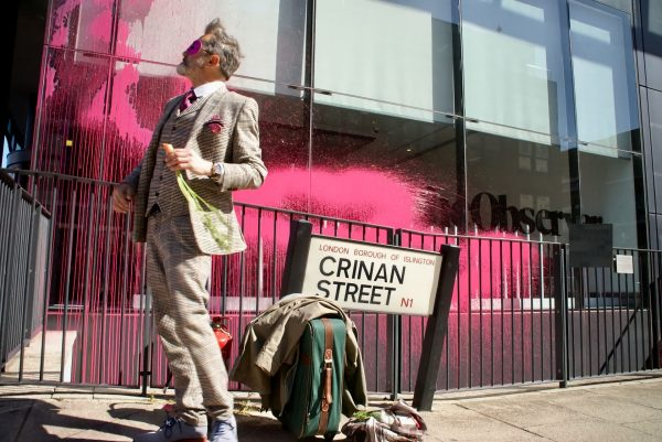Ramon Salgado-Touzon of Burning Pink Party outside The Guardian Offices with Pink Paint